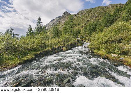Rapid Flow Of The Ak-kem River. Altai Landscape. Russia
