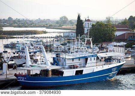 Keramoti, Greece - July 4, 2020: Fishing Boats at the Port of village of Keramoti, East Macedonia and Thrace, Greece