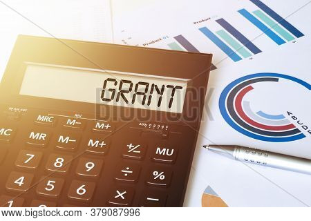 Word Grant On Calculator. Business And Finance Concept.