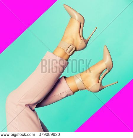 Sexy Legs In Brown High Heels Shoes On Blue Background. - Image