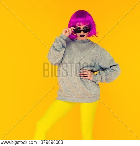 Fashion Girl Portrait On Yellow Background. Crazy Style Young Woman In Pink Wig - Image