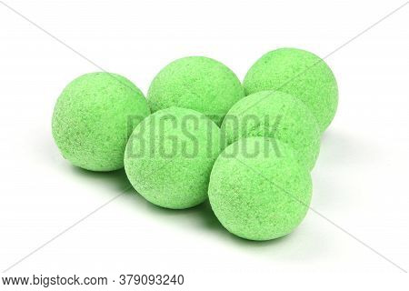Close Up View Of Green Boilies, Fishing Baits For Carp Isolated On White Background. High Resolution