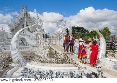 Chiang Ray, Thailand - December 16, 2018: Happy Tourists At The Entrance To The Buddhist Temple Wat