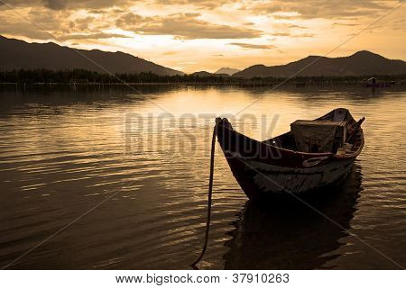 Landscape with boat, mountains, clouds and fisherman in Hue, Vietnam