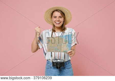 Happy Traveler Girl In Striped Shirt Hat With Photo Camera Isolated On Pink Background. Passenger Tr