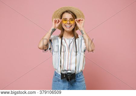 Cheerful Traveler Tourist Young Girl In Striped Shirt Glasses Hat With Photo Camera Isolated On Pink