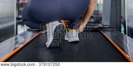 Sporty Woman Workout And Running In Machine Treadmill. Asian Woman Exercise And Lifestyle At Fitness