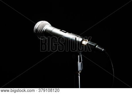 Black Classic Microphone On Black Dark Background. Music And Concert Concept.
