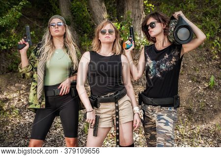 Group Of Three Beautiful And Attractive Woman Soldier Hold Guns