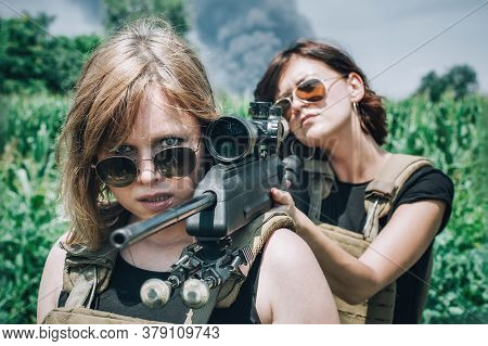 Female Soldier Shooting With Sniper Rifle. Woman With Weapon. Firearm Army Shooting And Tactical Tra