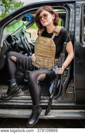 Beautiful And Attractive Female Military Soldier With Shotgun Pump Gun