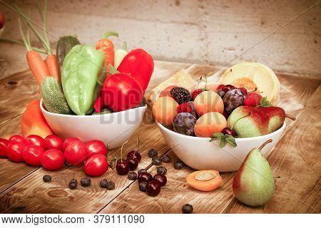 Healthy Fresh Organic Vegetarian Food, Fruit And Vegetable In Bowl On Rustic Table