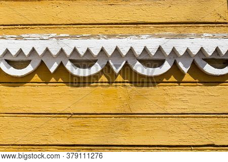 White Wood Carving On Yellow Walls In Russian Style