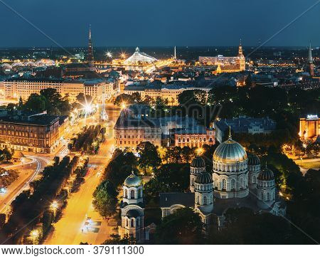 Riga, Latvia - July 2, 2016: Evening Night Aerial View Cityscape, Landmarks St. Peters Church, Boule