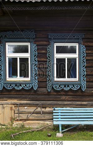Russian Windows With Carved Frames And Shutters In Village Houses
