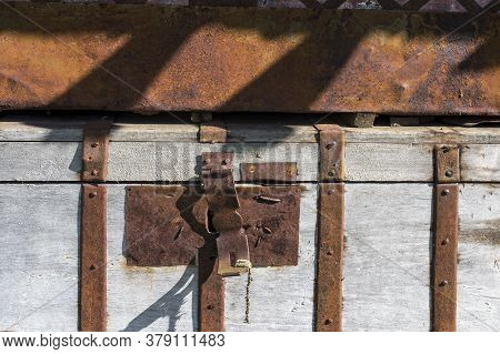 Old Metal Padlock On A Metal Wooden Door Of Barn