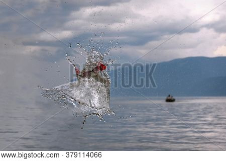 Abstract Funny Humorous Figure With A Face In Sunglasses Made Of Splashing Water And Spray, Resultin