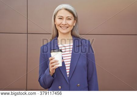 Coffee Pause. Beautiful Cheerful Middle Aged Business Woman Wearing Eyeglasses And Classic Suit Hold