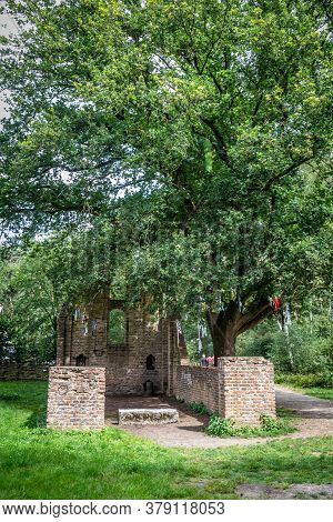 Ruin Of Saint Walrick Or Fever Chapel In Overasselt Netherlands. Pilgrims Come To The Chapel To Pray