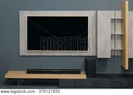 Large Television Screen On The Wall Of Modern Interior
