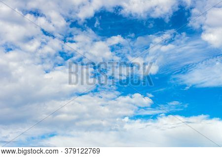 White Cumulus Clouds On A Blue Sky, Bright Sunny Day, Beautiful Natural Landscape