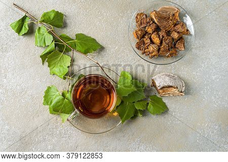 Healing Infusion Of Chaga Birch Mushrooms In Glass Cups And Chaga Pieces On A Wooden Table. A Trendy