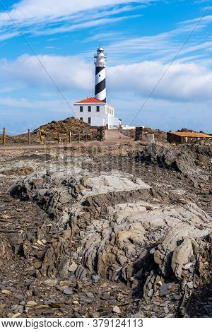 Favaritx Lighthouse In Natural Reserve On The Island Of Menorca. Spain