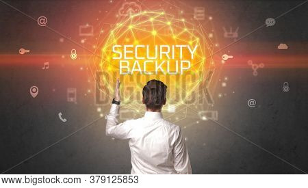 Rear view of a businessman with SECURITY BACKUP inscription, online security concept