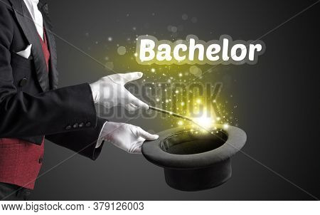 Magician is showing magic trick with Bachelor inscription, educational concept