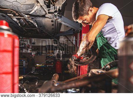 Professional Mechanic Man Fixing The Rusty Car Bearing
