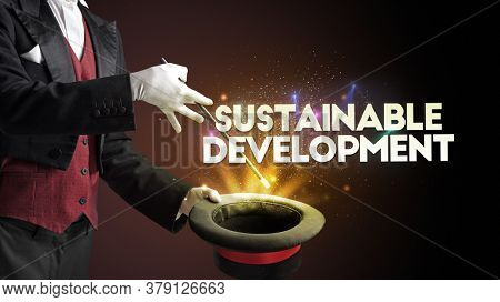 Illusionist is showing magic trick with SUSTAINABLE DEVELOPMENT inscription, new business model concept