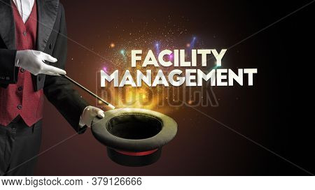 Illusionist is showing magic trick with FACILITY MANAGEMENT inscription, new business model concept
