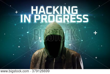 Mysterious hacker with HACKING IN PROGRESS inscription, online attack concept inscription, online security concept