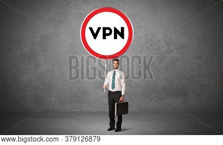 Young business person holdig traffic sign with VPN abbreviation, technology solution concept