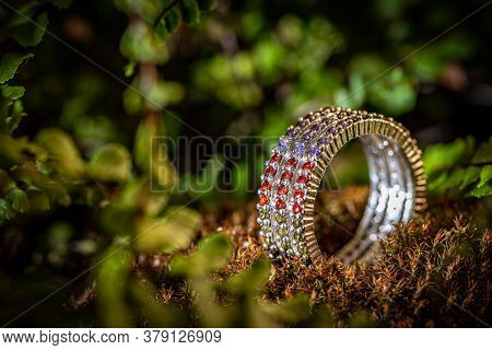 Modern Style Silver Ring With Colorful Small Crystals On Wild Background