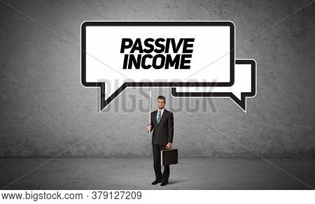 Young business person in casual holding road sign with PASSIVE INCOME inscription, new business idea concept