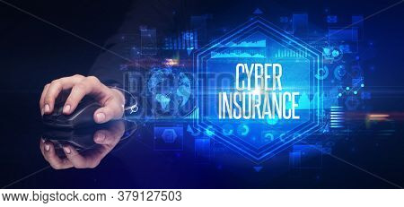 hand holding wireless peripheral with CYBER INSURANCE inscription, cyber security concept