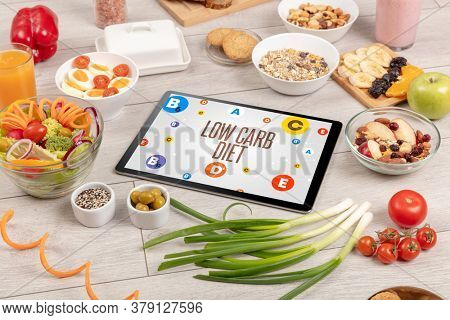 Healthy Tablet Pc compostion with LOW CARB DIET inscription, weight loss concept