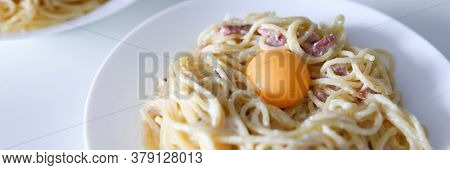 Carbonara Pasta With Egg Yolk And Bacon Closeup Background. Fast Food Delivery Concept
