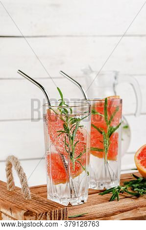 Grapefruit Tonic Water With Rosemary On White Wooden Background. Healthy Lifestyle. Metal Drinking S