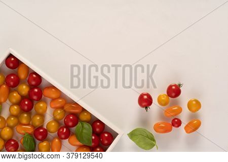 fresh italian cherry tomatoes on the vine in a wooden crate on a  background