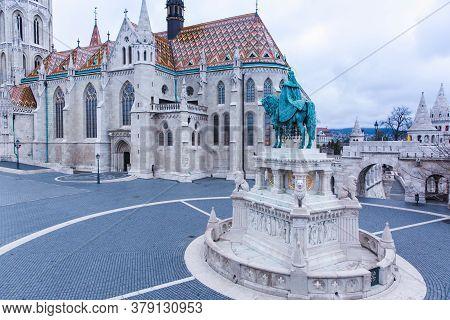 Catholic Matthias Church And Statue Of Saint Stephen On Fishermans Bastion In Budapest, Hungary