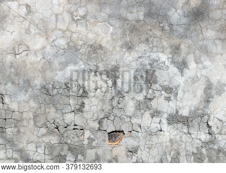 Grunge background with texture of old wall and cracked stucco of gray color. Mock up template. Copy space for text