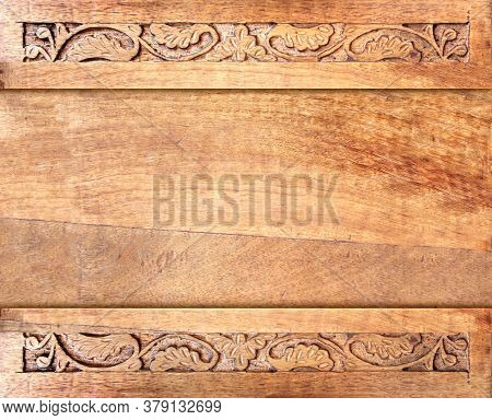 Horizontal background with wood frame and carving floral ornament. Decorative carved border on wooden surface. Mock up template. Copy space for text