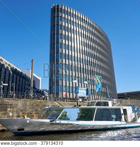 Berlin, Germany - May 31,2020: Excursion Boat On The River Spree In Berlin. In The Background The Mo