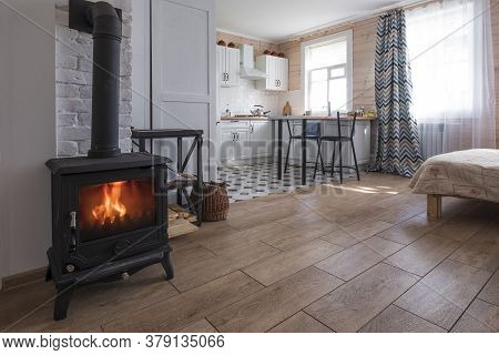 Interior Of A Bright Studio Room With A Scandinavian Style Fireplace In A Private House, Where The L