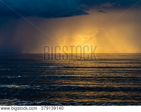The Baltic Sea At Sunset, Stormy Dramatic Clouds. Storm Passing Over Sea, Sunset And Dark Clouds Aft