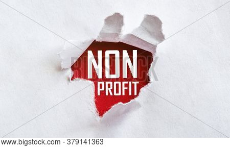 White Torn Paper With Text Non Profit On Red Background