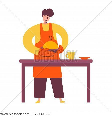 Young Man In An Apron Holding A Pie. Baker Cooking Pie For Holiday. Confectioner. Family Time. Male