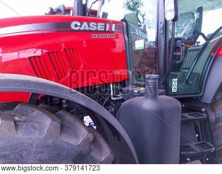 Kyiv, Ukraine - August 2, 2020: Case Ih Tractor 225 And Logo At Kyiv, Ukraine On August 2, 2020. Cas